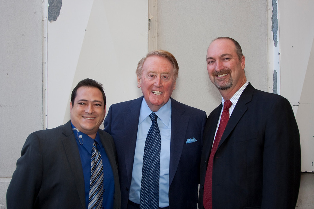 Ruzzo Martinelli (HRTS), Vin Scully and Dave Ferrara (Exec. Director, HRTS).